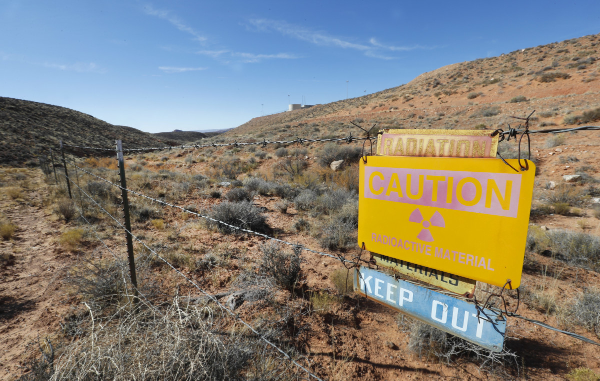 A radioactive warning sign hangs on fencing around the Anfield's Shootaring Canyon Uranium Mill on October 27th, 2017, outside Ticaboo, Utah.