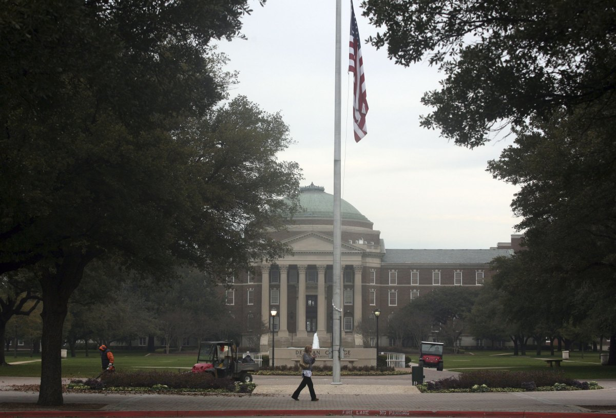 A student walks in front of Dallas Hall on the Southern Methodist University campus in Dallas, Texas.