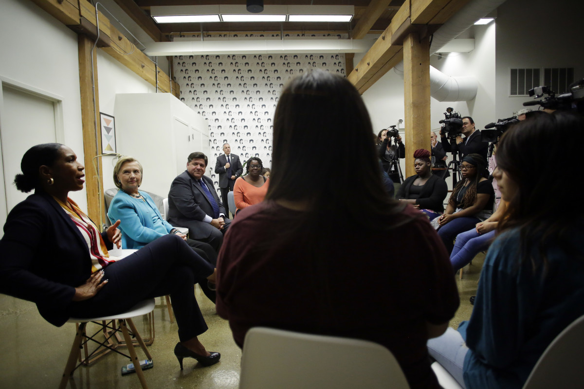 Illinois lieutenant governor candidate Juliana Stratton speaks with high school students during a round table discussion as former Secretary of State Hillary Clinton and Illinois gubernatorial candidate J.B. Pritzker listen at a creative workspace for women on October 1st, 2018, in Chicago, Illinois. Stratton, Clinton, and Pritzker spoke to students about leadership.