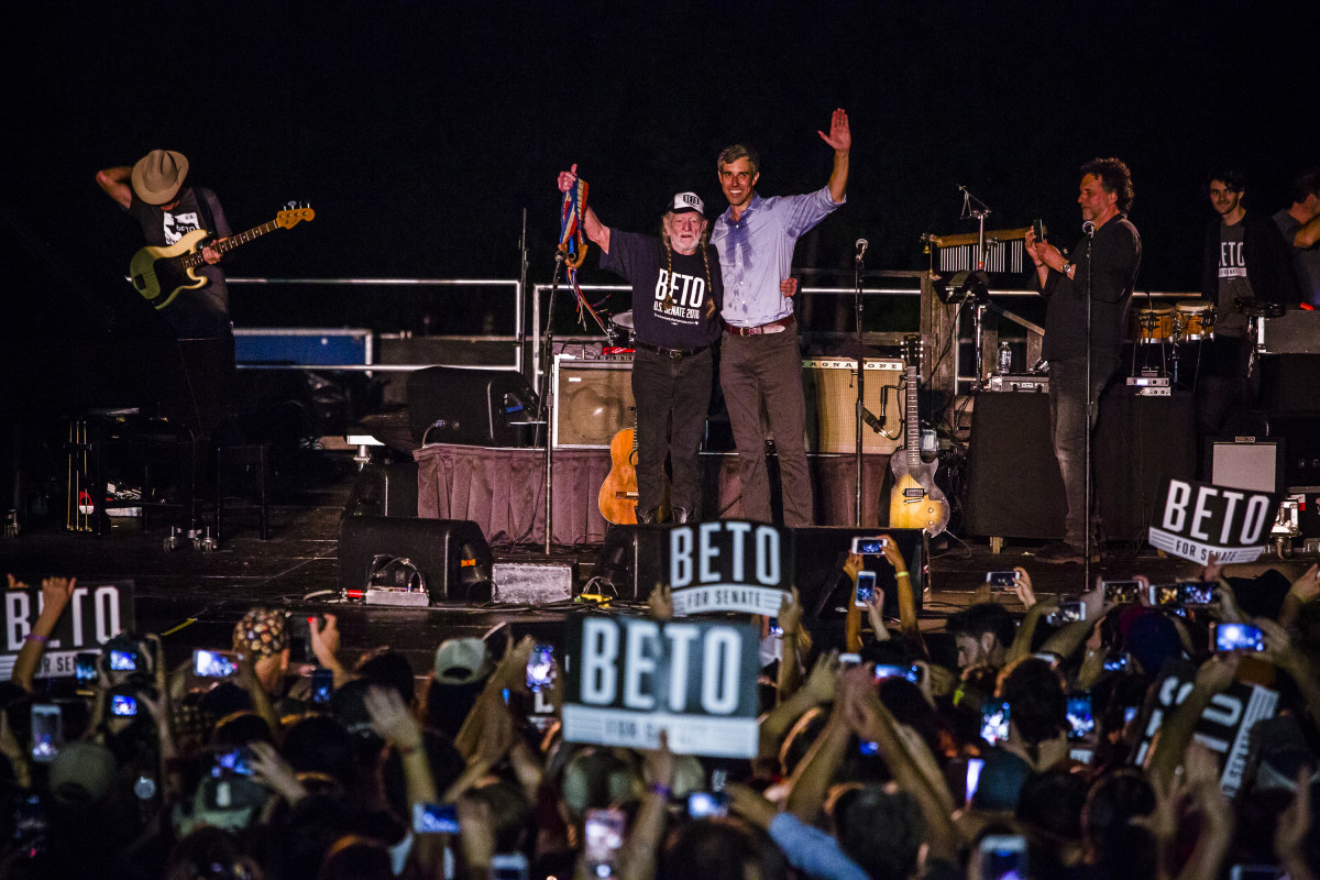 Representative Beto O'Rourke (D-Texas), joined by singer Willie Nelson, waves to supporters at a campaign rally at Auditorium Shores on September 29th, 2018, in Austin, Texas. O'Rourke is running against Republican incumbent Ted Cruz for his Senate seat.