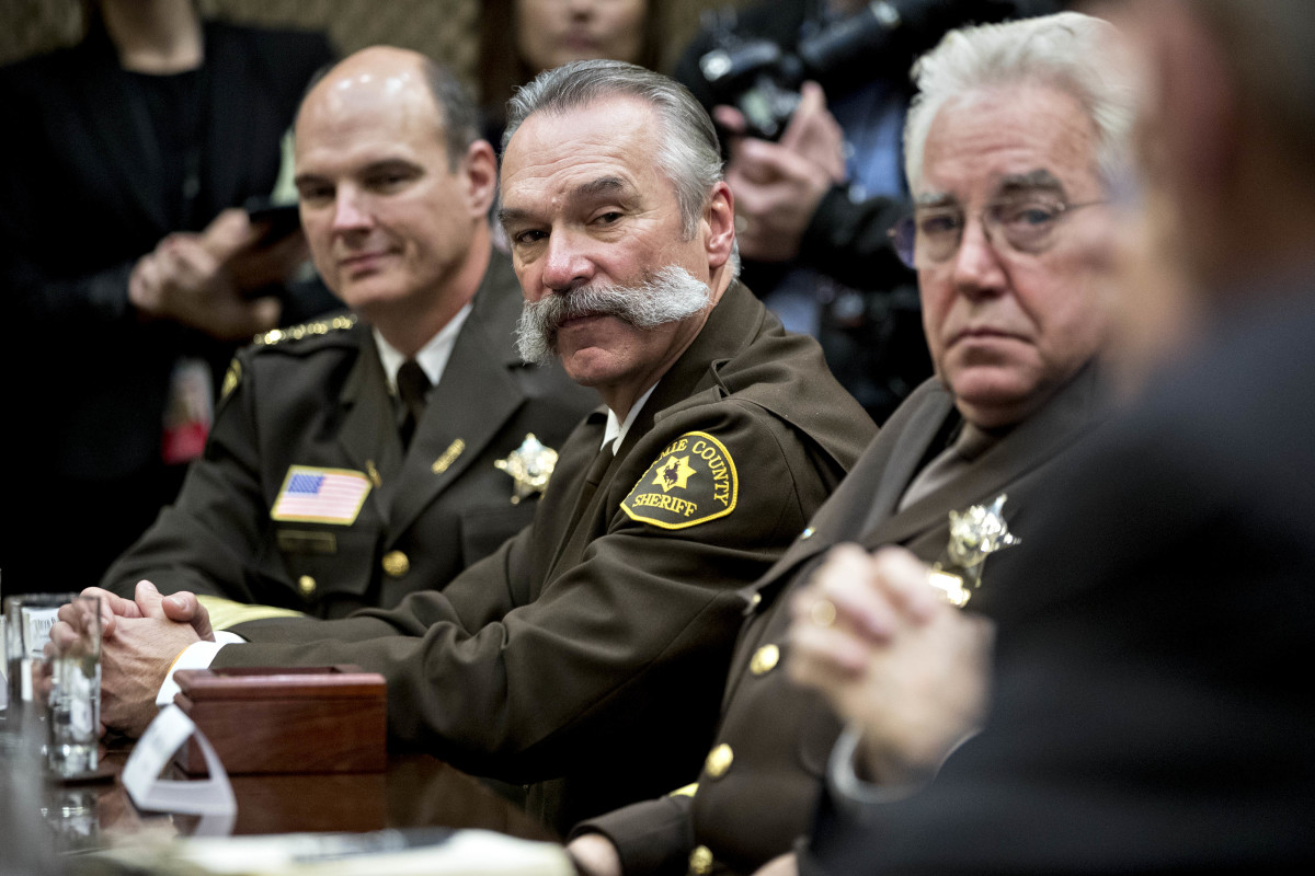 Richard Stanek, sheriff from Hennepin County, Minnesota (left), Danny Glick, sheriff from Laramie County, Wyoming (center), and John Layton, sheriff from Marion County, Indiana (right), at a listening session with President Donald Trump in the Roosevelt Room of the White House on February 7th, 2017.