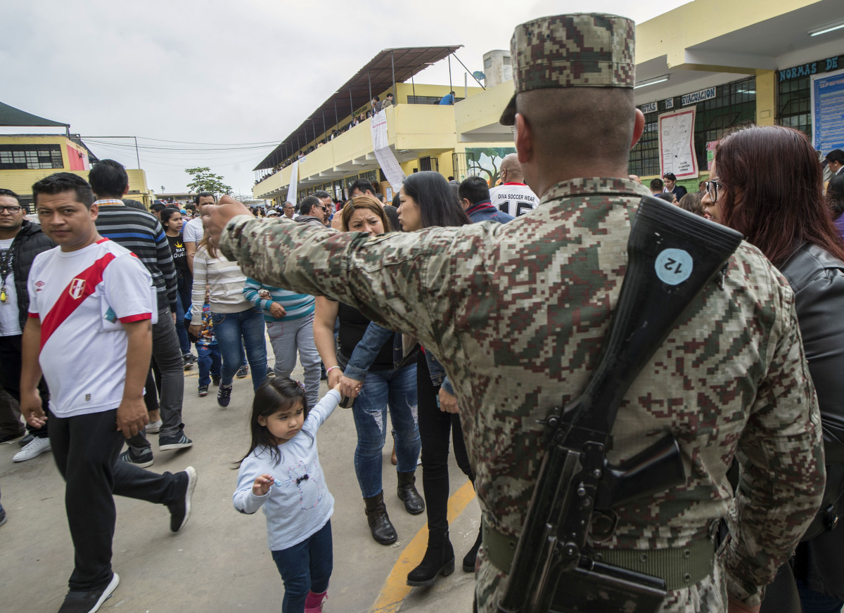 A Peruvian soldier stands guard at a polling station during municipal elections in Lima, Peru, on October 7th, 2018. More than 23 million Peruvians have been called to the polls to elect regional governors and mayors.