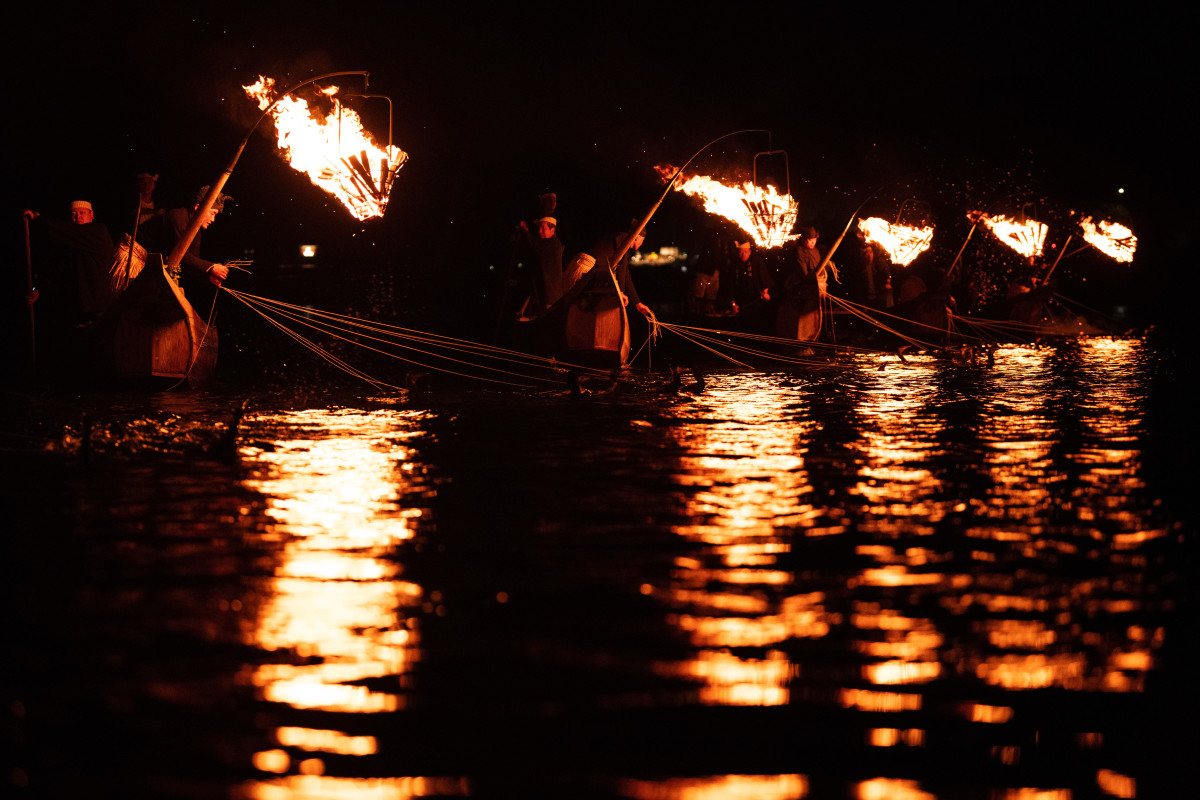Cormorant fishermen use sea cormorants to catch sweetfish on October 9th, 2018 in Gifu, Japan. In this traditional fishing art, 'ukai,' a cormorant master called 'usho' manages the birds to capture ayu, or sweetfish. The ushos of River Nagara have been the official staff of the Imperial Household Agency of Japan since 1890. Currently, six fishermen of the Nagara River conduct special fishing for the Imperial family eight times a year, on top of daily fishing from mid-May to mid-October.