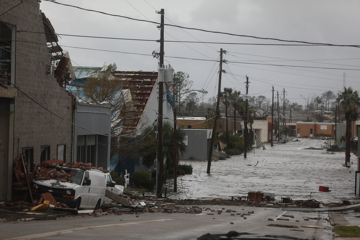 Damaged buildings and a flooded street are seen after Hurricane Michael passed through the downtown area of Panama City, Florida, on October 10th, 2018. The hurricane hit the Florida Panhandle as a Category 4 storm.
