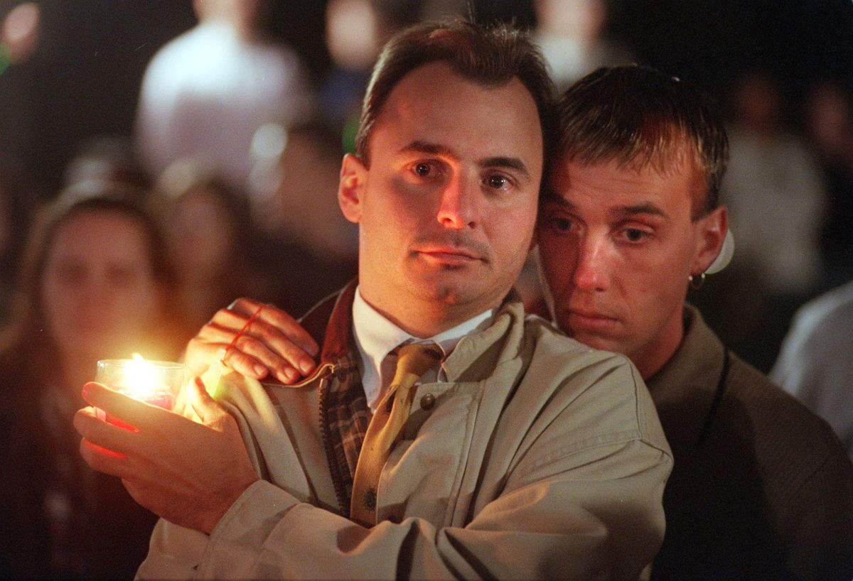 Two men embrace each other at a vigil for Matthew Shepard at the Capitol in Washington, D.C., on October 14th, 1998, two days after he died. Thousands converged outside the Capitol to call for political action to help stop hate crimes and to draw attention to victims of anti-gay violence.