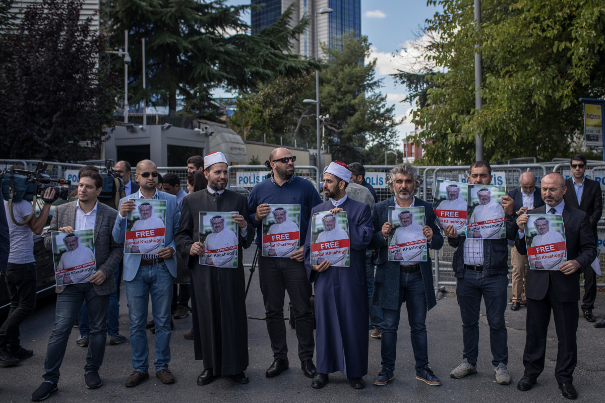 People hold posters of Khashoggi during a protest organized by members of the Turkish-Arabic Media Association at the entrance to the Saudi Arabian consulate on October 5th, 2018, in Istanbul, Turkey.