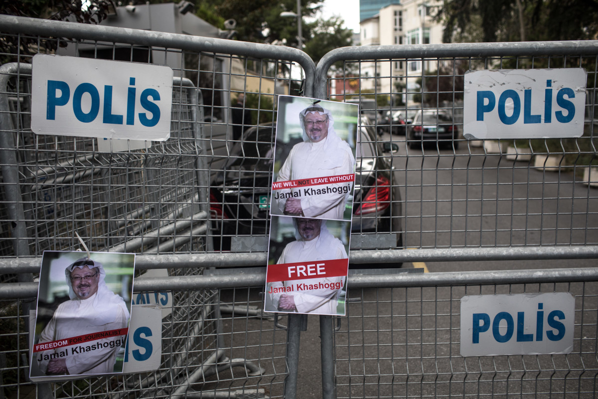 Posters of Khashoggi are stuck to a police barricade in front of Saudi Arabia's consulate on October 8th, 2018, in Istanbul, Turkey.