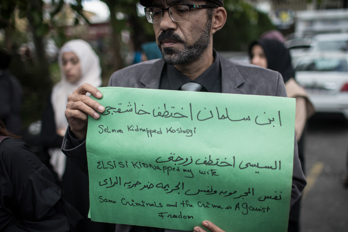 A man holds a poster during a protest organized by members of the Turkish-Arabic Media Association at the entrance to Saudi Arabia's consulate on October 8th, 2018, in Istanbul, Turkey. Fears are growing over the fate of missing journalist Jamal Khashoggi after Turkish officials said they believe he was murdered inside the Saudi consulate. Saudi consulate officials have said that Khashoggi went missing after leaving the consulate. However, the statement directly contradicts other sources, including Turkish officials.