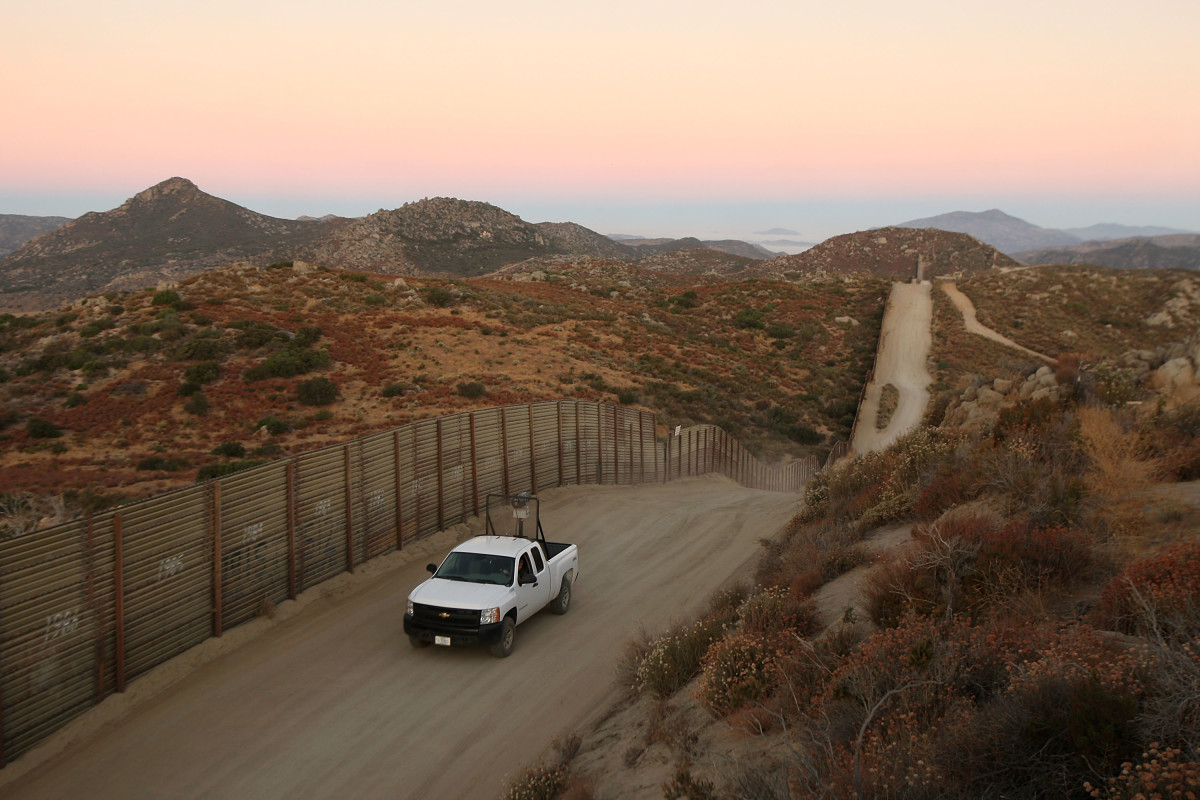 A U.S. Border Patrol agent searches for tracks after a night of surveillance using night-vision equipment as agents carry out special operations near the U.S.-Mexico border fence.