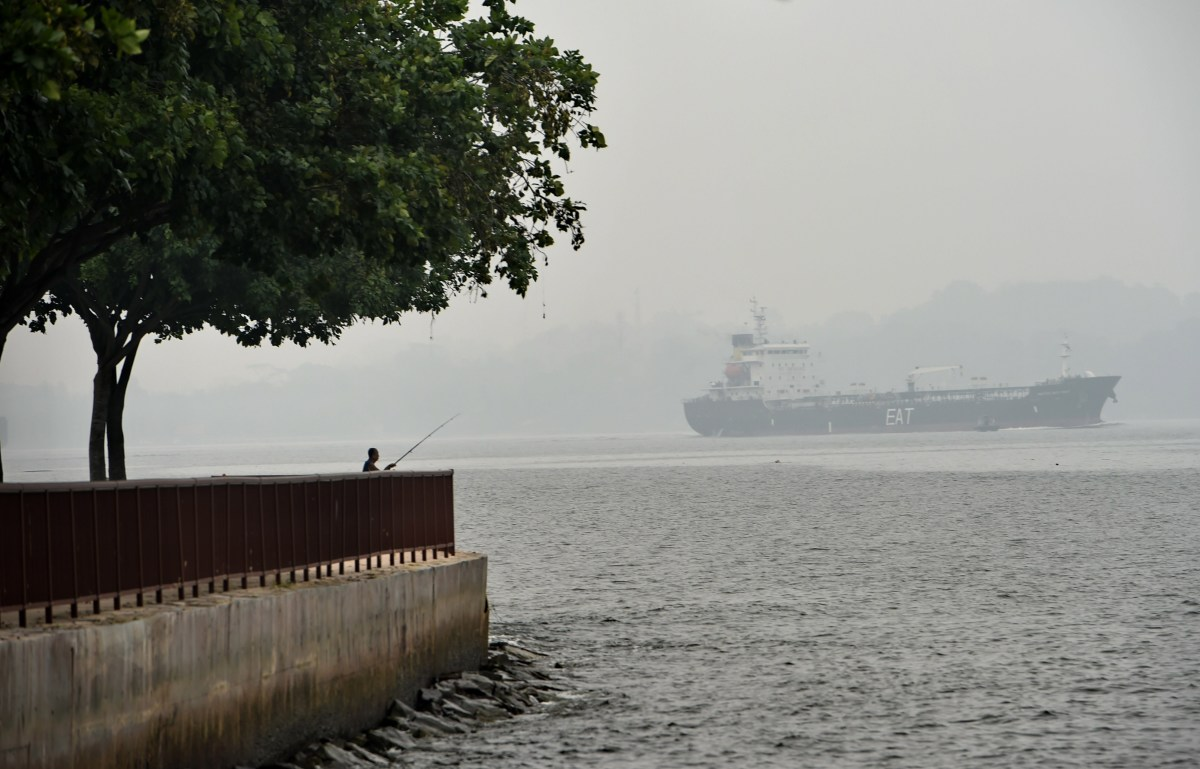A vessel sails along the hazy Singapore strait on October 6th, 2015.