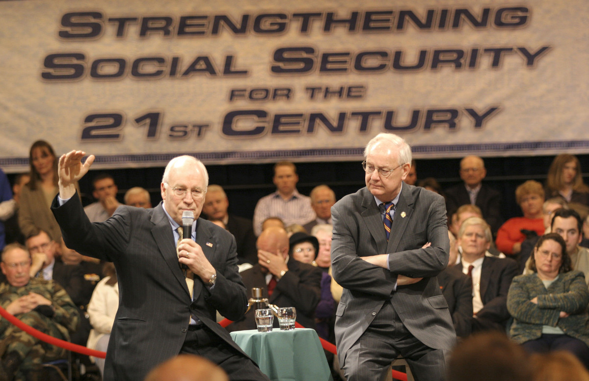 U.S. Vice President Dick Cheney (L) gestures as he speaks at a town hall meeting on social security as U.S. Congressman Joe Schwarz (R-MI) listens March 24th, 2005, in Battle Creek, Michigan.