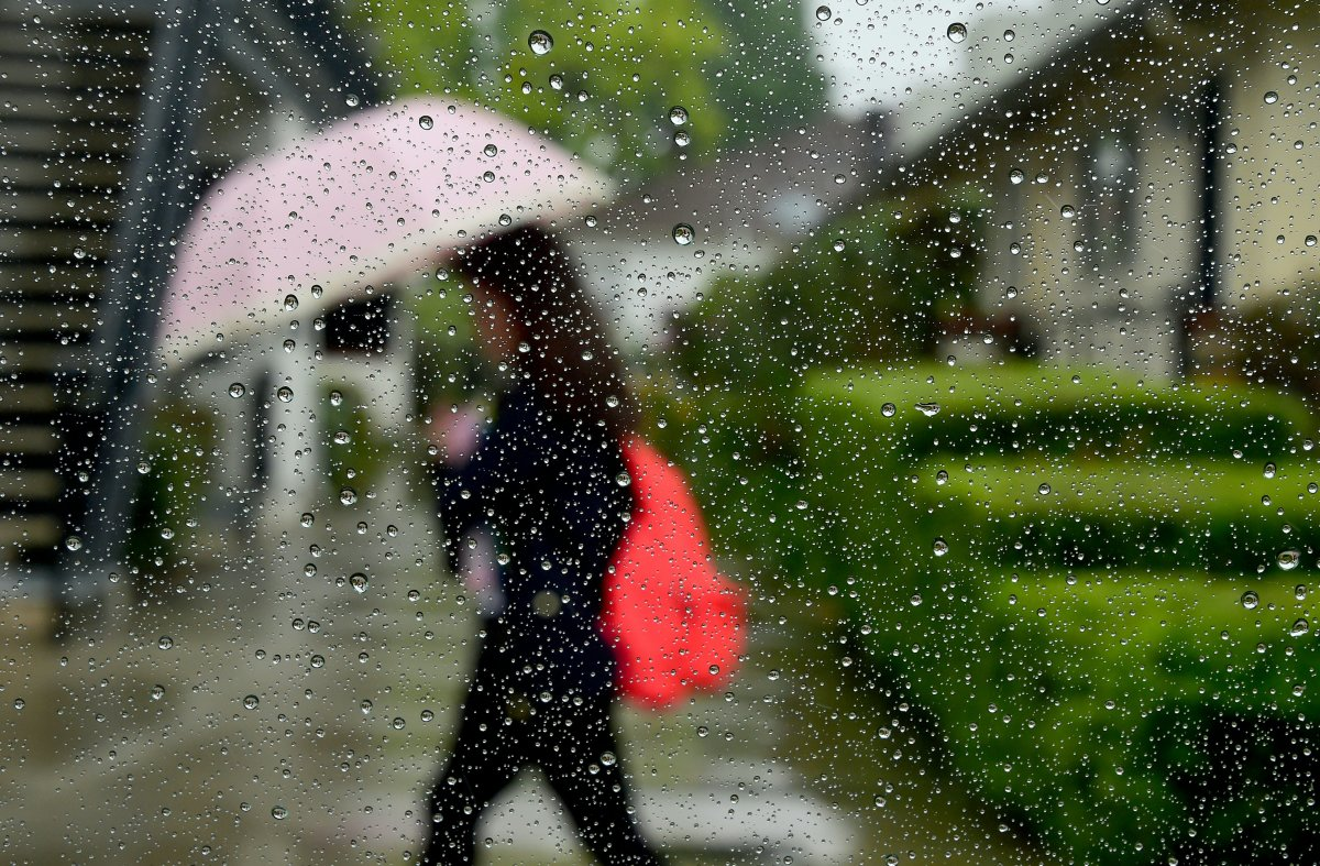 A pedestrian uses her umbrella in the rain in Alhambra, California, on April 8th, 2016.