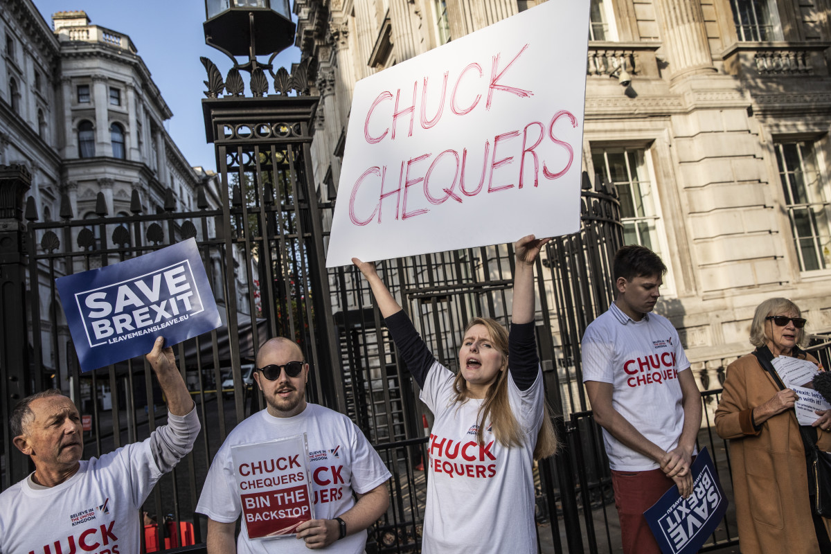 "Pro-Brexit demonstrators gather outside Downing Street calling for a hard-line withdrawal from the European Union during the weekly Cabinet Meeting at Downing Street on October 16, 2018 in London, England. ""Chuck Chequers"" refers to the so-called Chequers plan worked out in July."