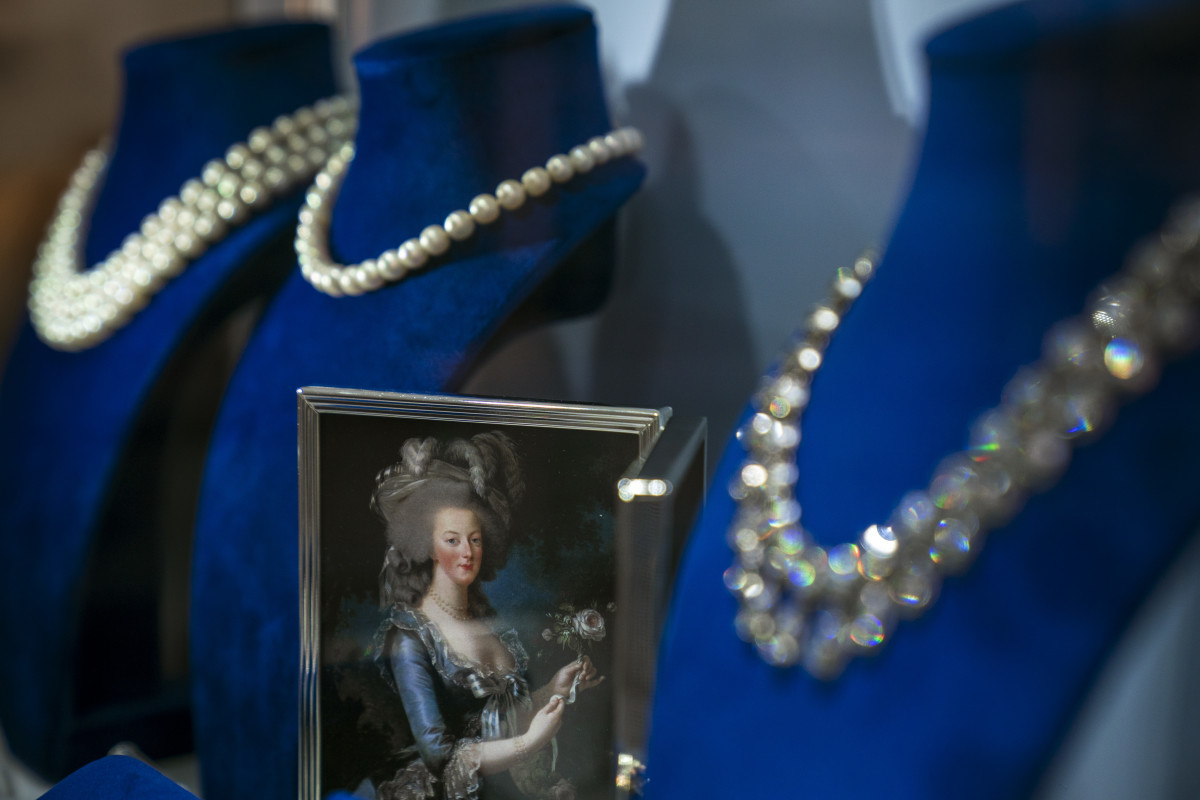 A photograph of French Queen Marie Antoinette is displayed among her jewelry at Sotheby's auction house, October 12th, 2018, in New York City. The collection of aristocratic jewels, belonging to the Bourbon-Parma family, is set to hit the auction block on November 14th.