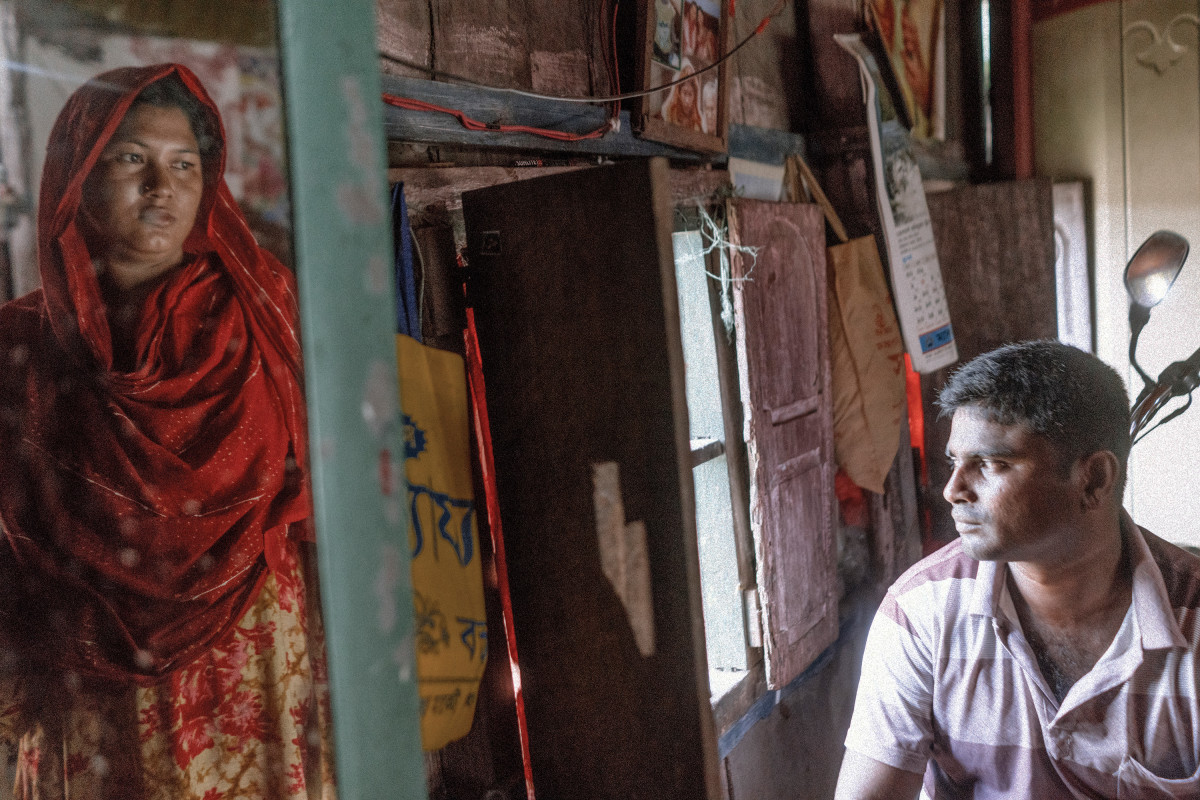 "When asked why he and his wife chose not to move to India after the exchange of territories, Mahabubbar Rahman Sarkar said, ""Because we're Bangladeshi, and we love being here."" He says that when his village was a chhitmahal, there had been much theft, robbery, and murder, but now things are better, and there is opportunity."