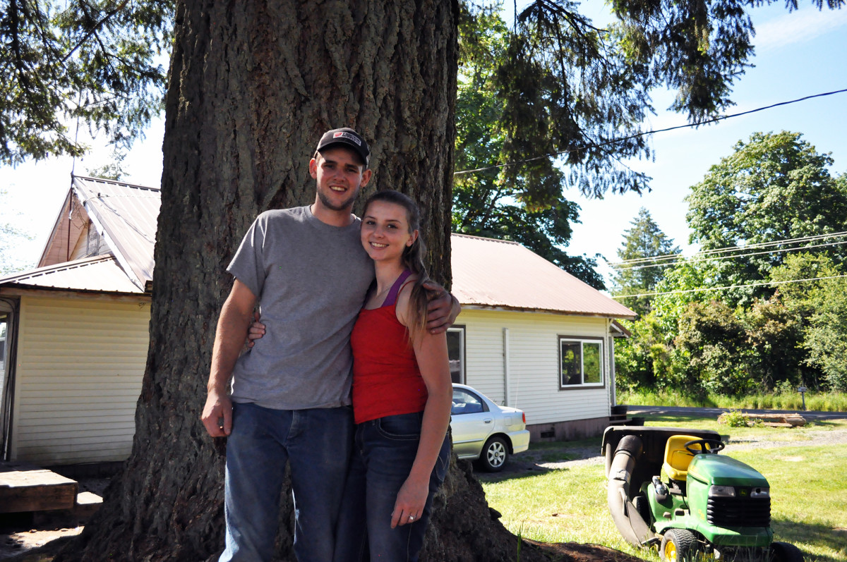 Hunter Blair and his fiancée, Ronnie Kinsman, pose in the field behind their home on June 2nd, 2018, in Onalaska, Washington. The pair graduated from Onalaska High School in 2017 and 2016 respectively, and say they intend to settle down in their hometown.