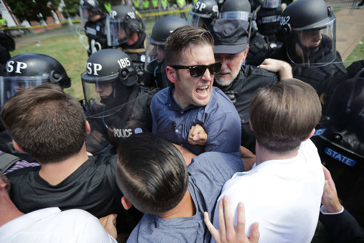 """White nationalist Richard Spencer and his supporters clash with Virginia State Police in Emancipation Park after the """"Unite the Right"""" rally was declared an unlawful gathering August 12th, 2017, in Charlottesville, Virginia."""
