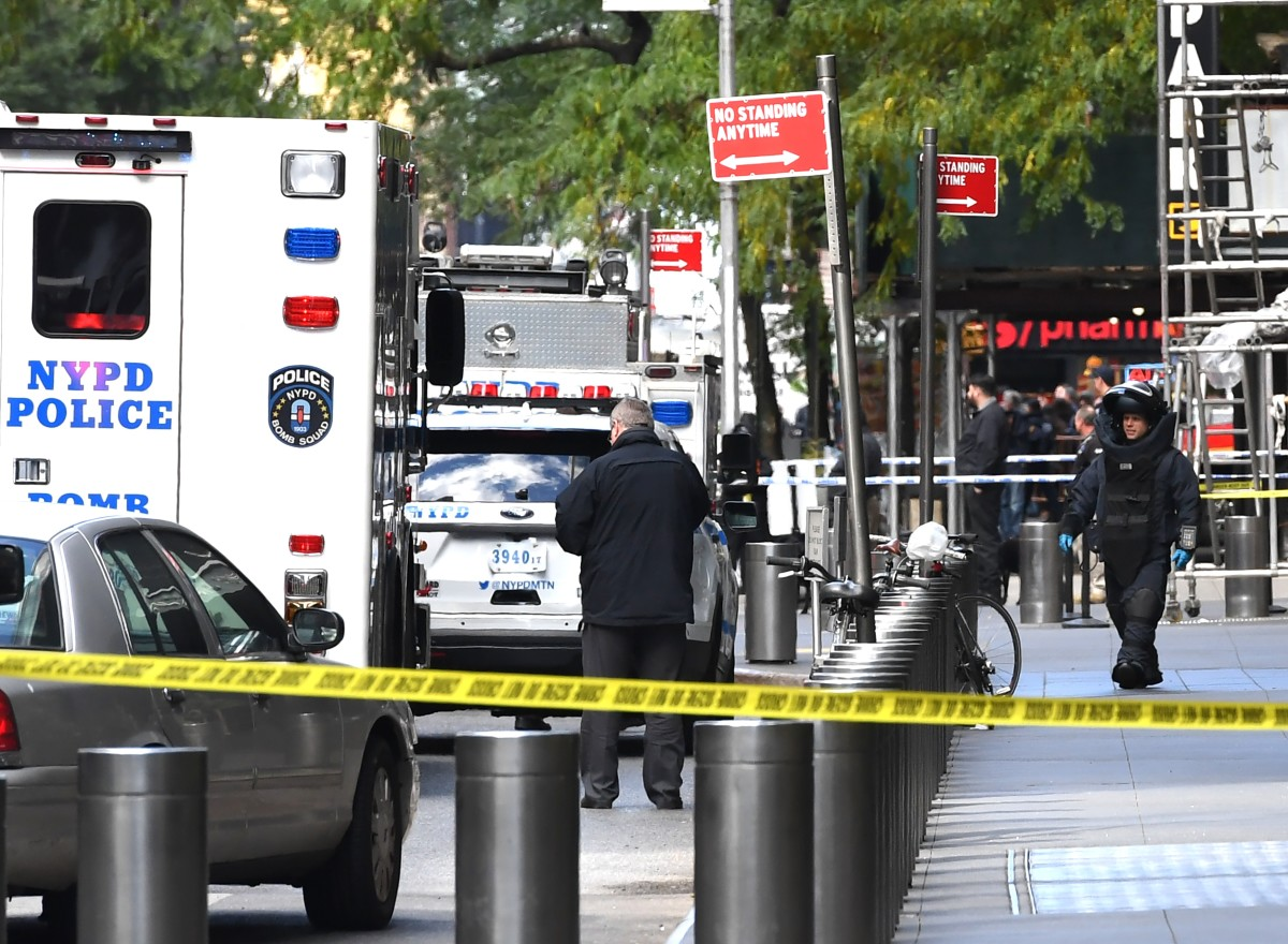 A New York Bomb Squad officer walks out of the Time Warner Building in Manhattan, New York, on October 24th, 2018, after a suspected explosive device was delivered to CNN's New York bureau. The bomb was addressed to John Brennan, President Barack Obama's former Central Intelligence Agency director and a critic of President Donald Trump. Bombs were also sent to Obama and other prominent Democrats like Hillary Clinton, Maxine Waters, and George Soros.