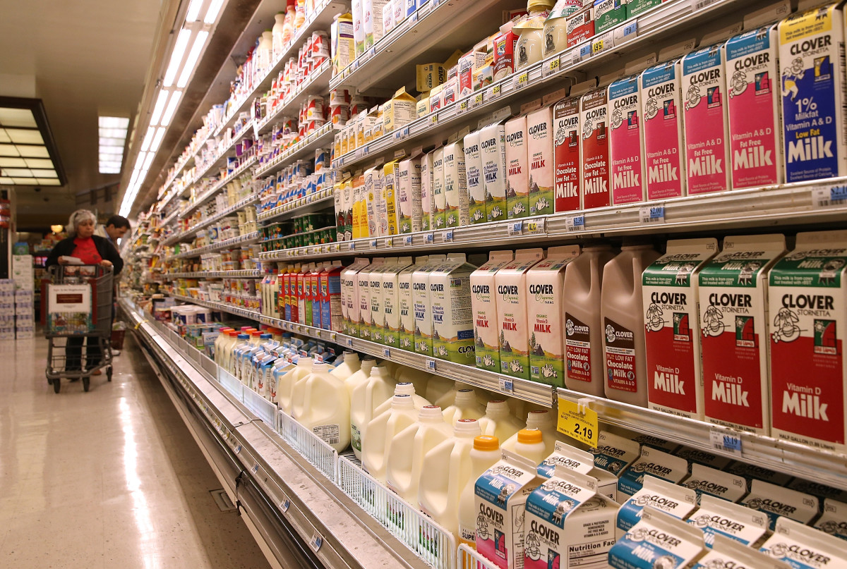 Containers of milk are displayed at Cal-Mart Grocery in San Francisco, California.
