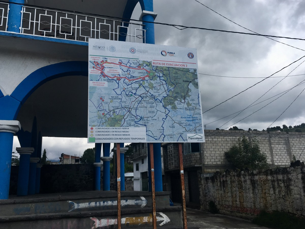 A sign depicts the evacuation route in Santiago Xalitzintla, the closest town to the volcano, sits in front of city hall.