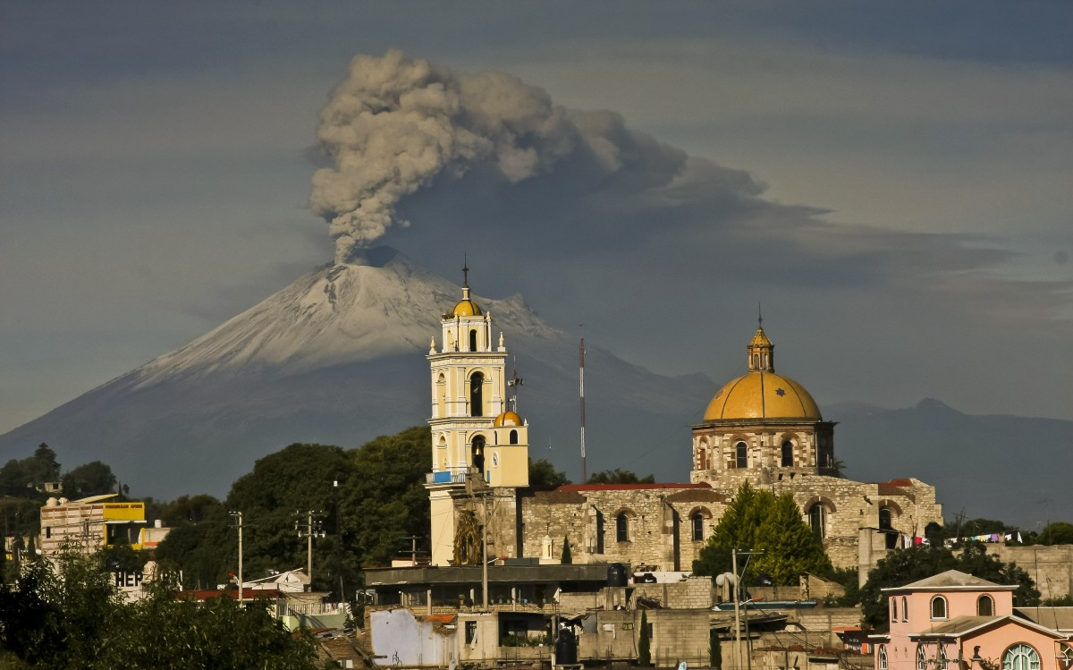 Ash spews from Popocatepetl, as seen from San Damian Texoloc municipality, on July 9th, 2013.