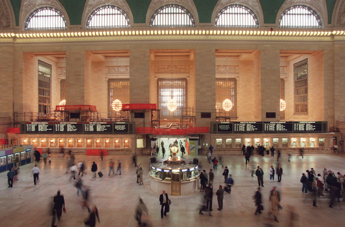 Commuters and train passengers walk through the main concourse of of Grand Central Station.