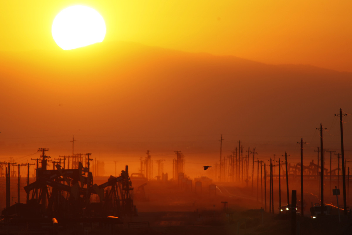 The sun rises over an oil field in Lost Hills, California, on March 24th, 2014.