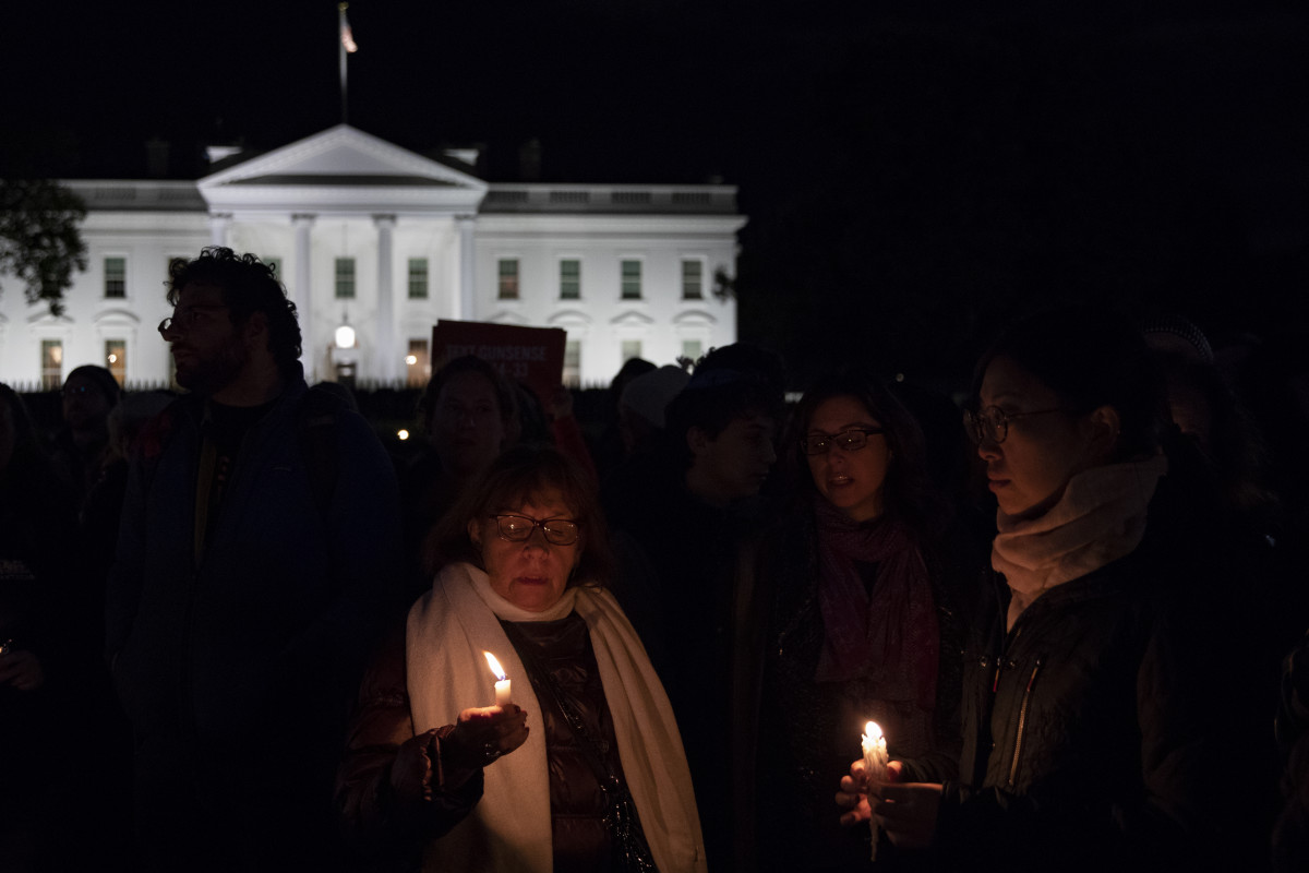 Vigil participants hold candles and sing a Jewish prayer in front of the White House on October 27th, 2018, during a vigil for the victims of the Tree of Life Congregation shooting.
