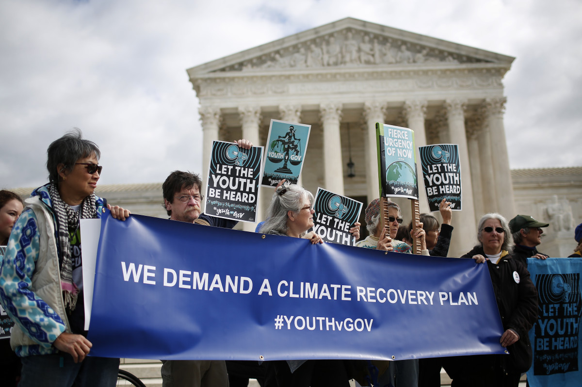 Protesters attend a rally held by the group Our Children's Trust on October 29th, 2018, outside the United States Supreme Court in Washington, D.C. The group rallied in support of the Juliana v. U.S. lawsuit brought on behalf of 21 youth plaintiffs that argues the U.S. government has violated constitutional rights for more than 50 years by contributing to climate change.