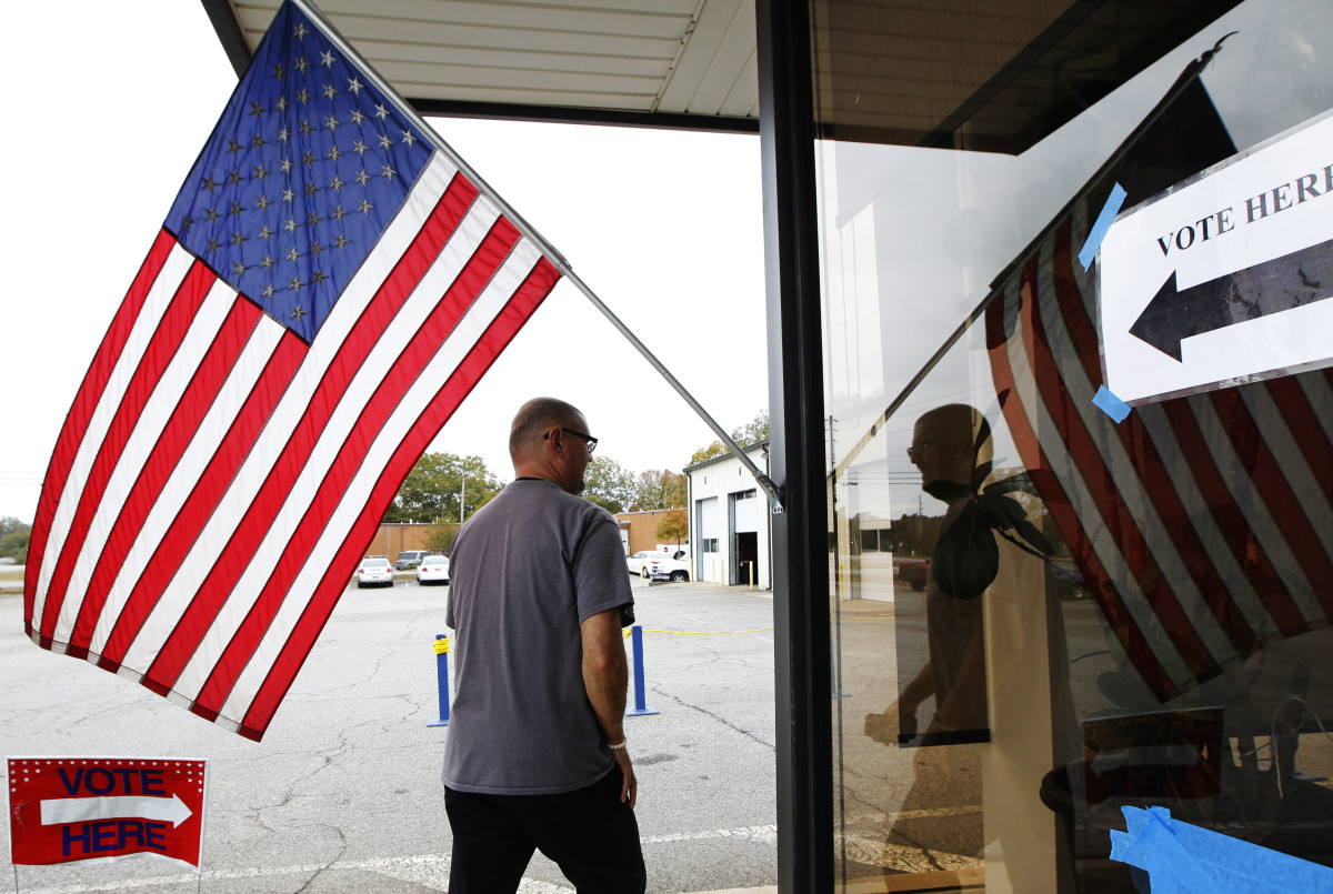 A voter heads to a polling station in Athens, Georgia, on November 8th, 2016. In the past decade, the number of registered voters removed from the rolls across the South due to a conviction has nearly doubled.