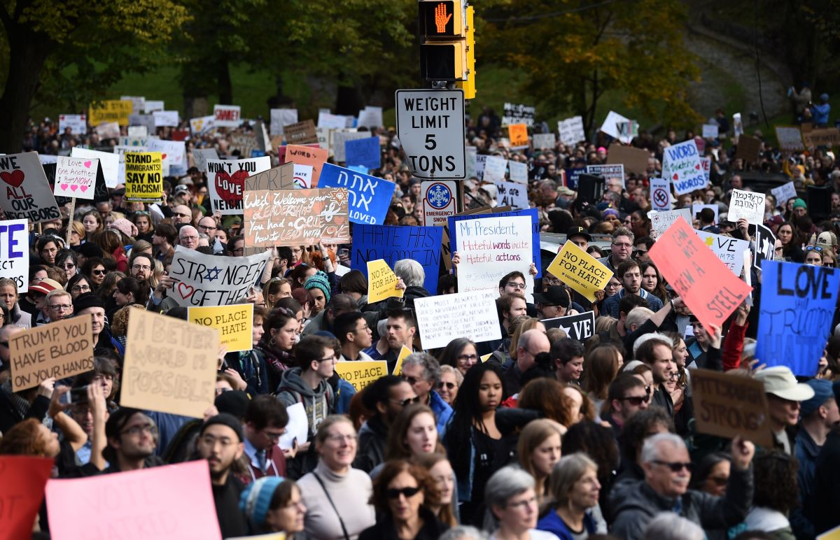 "Scores of protesters took to the streets of Pittsburgh to denounce a visit by U.S. President Donald Trump in the wake of a mass shooting at a synagogue that left 11 people dead. Demonstrators gathered near the Tree of Life synagogue, where the shooting took place, holding signs that read ""President Hate, Leave Our State!"" and ""Trump, Renounce White Nationalism Now."""