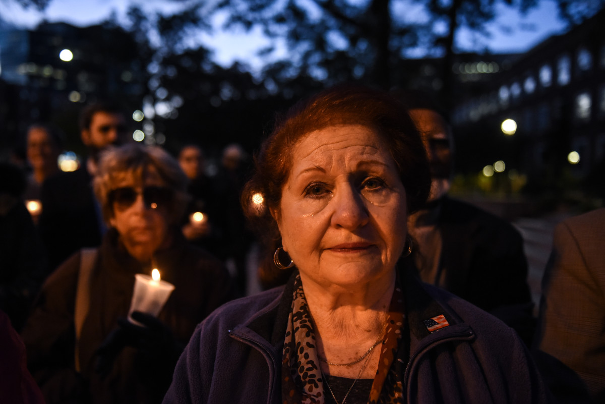 Sarah Goodman, a Queens resident, participates in a candlelight vigil in memory of the victims of the mass shooting at the Tree of Life synagogue on the steps of Queens Borough Hall on October 29th, 2018, in New York City.