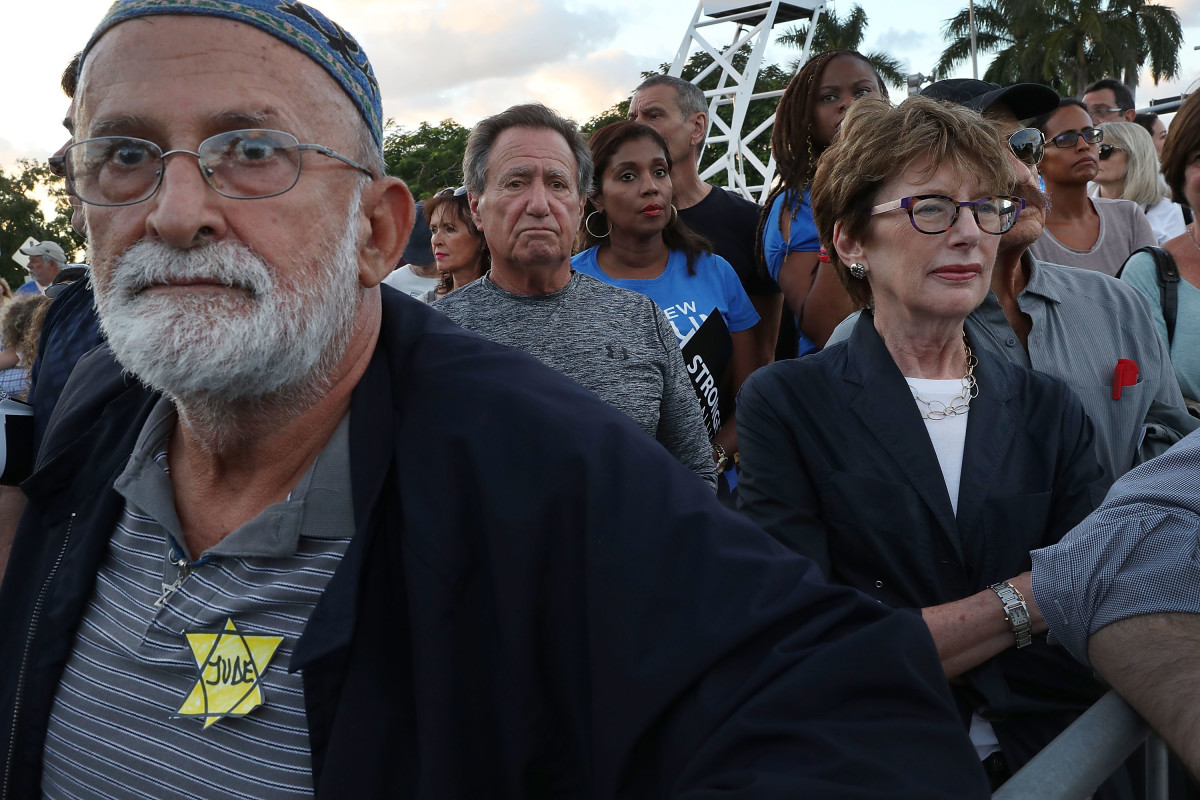 Marco Arias, wearing the symbol Nazis used to identify Jews during the Holocaust, joins with others for a community solidarity vigil at the Holocaust Memorial Miami Beach on October 30th, 2018, in Miami Beach, Florida.
