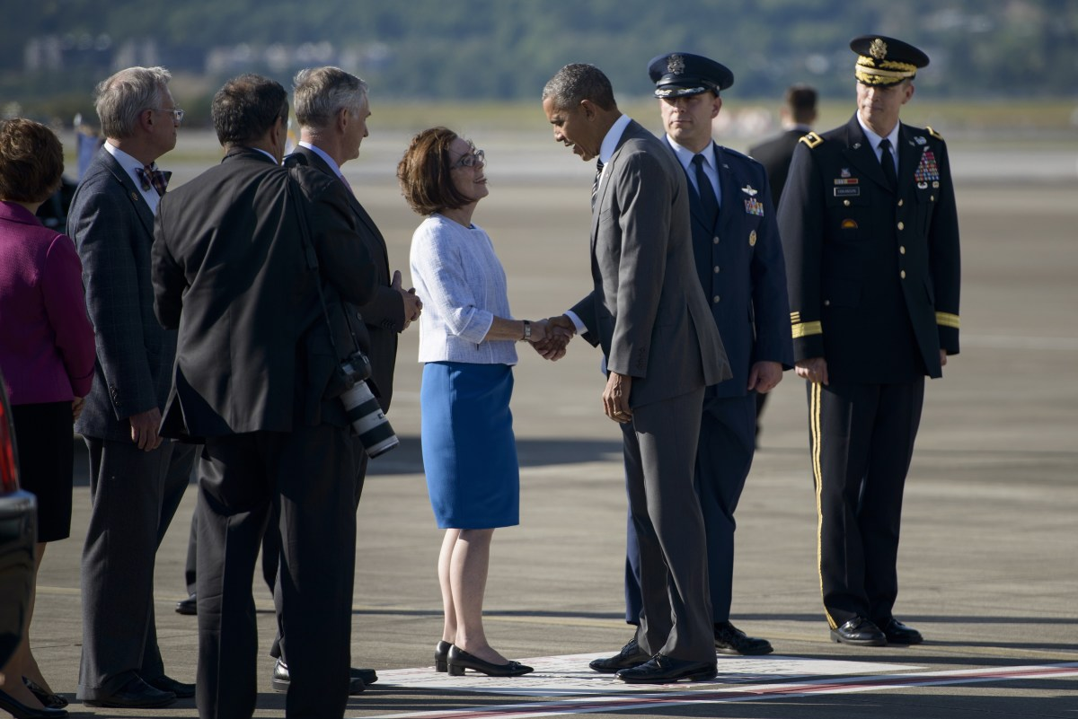 Governor Kate Brown greets President Barack Obama is at the Oregon Air National Guard Base on May 7th, 2015, in Portland, Oregon.