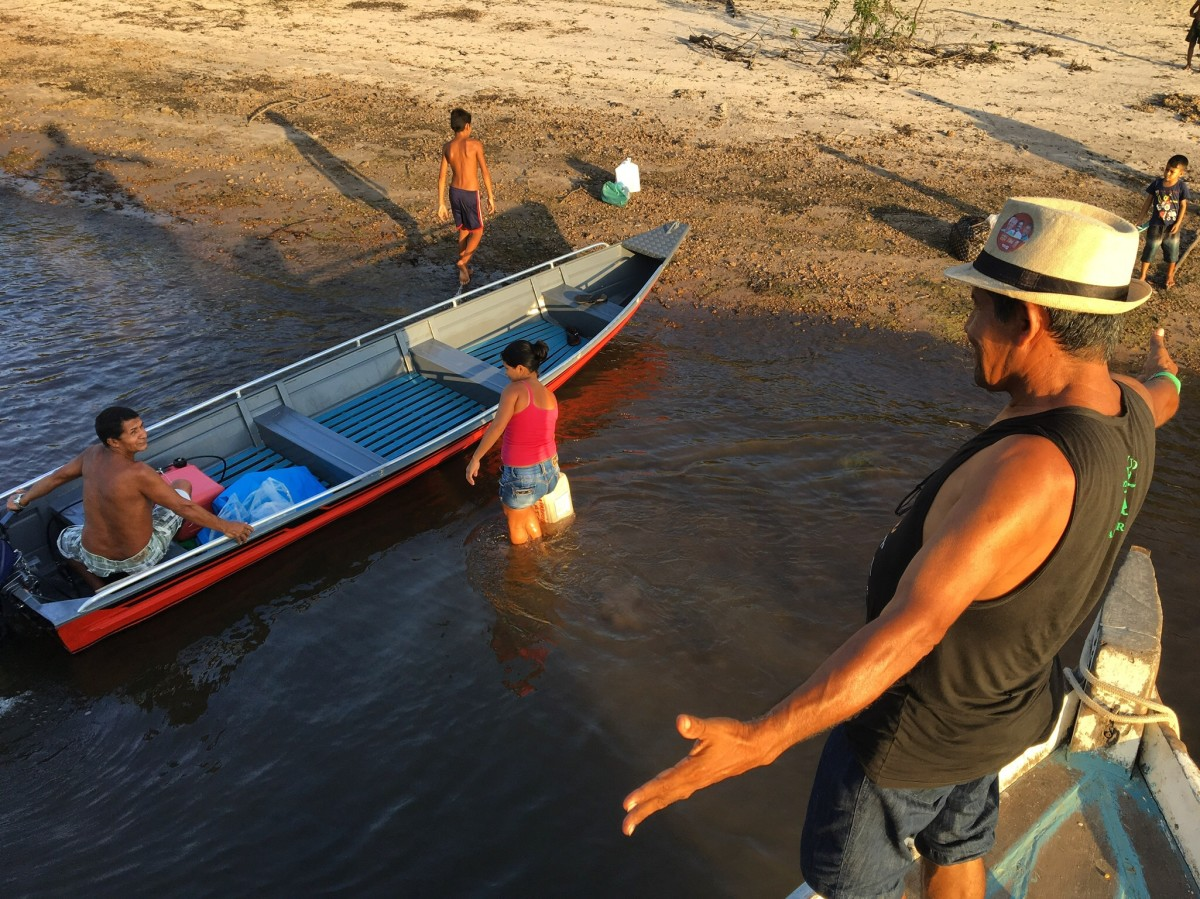 Voting in Brazil's presidential election — Livaldo Sarmento greets villagers from a neighboring community along the Arapiuns River. Many of the ribeirinhos along the river know each other from trips on the boats.