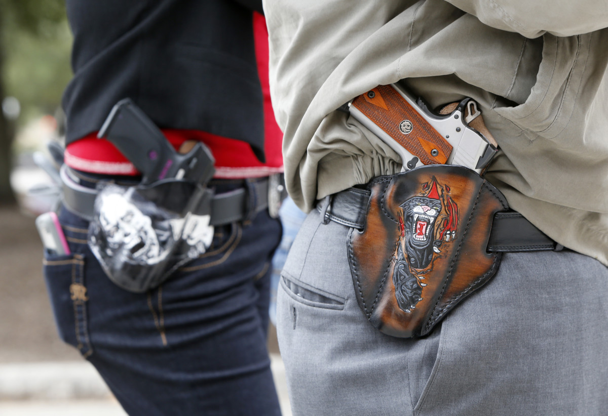 People carry pistols on January 1st, 2016 in Austin, Texas.