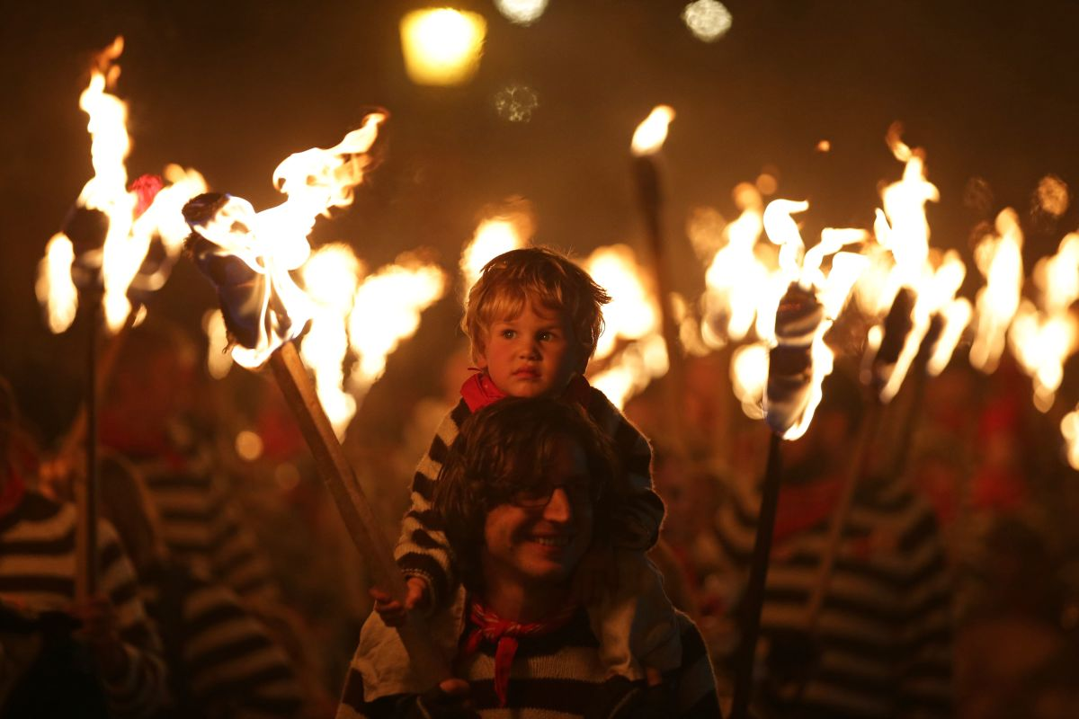 "Revelers parade through the streets of Lewes in East Sussex, southern England, on November 5th, 2018, during traditional Bonfire Night celebrations. Thousands of people attended the annual parade through the narrow streets until the evening came to an end with the burning of an effigy or ""guy,"" usually representing Guy Fawkes, who died in 1605 after an unsuccessful attempt to blow up the Houses of Parliament."