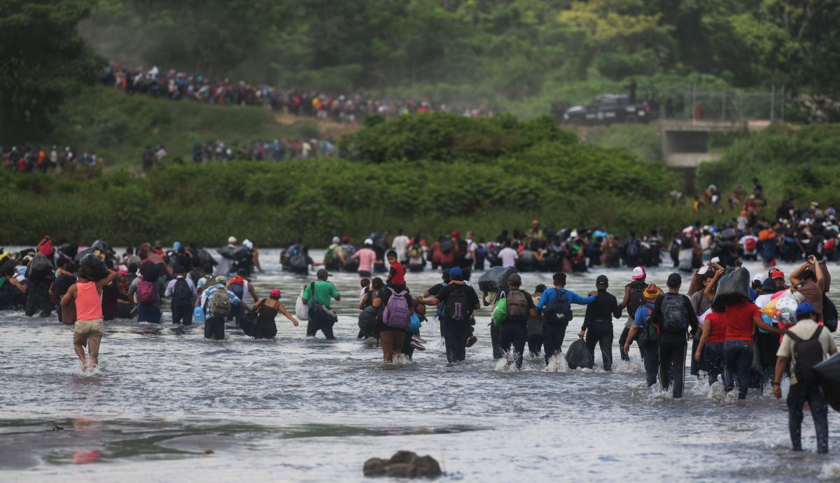 Salvadorean migrants heading in a caravan to the U.S., cross the Suchiate River to Mexico.
