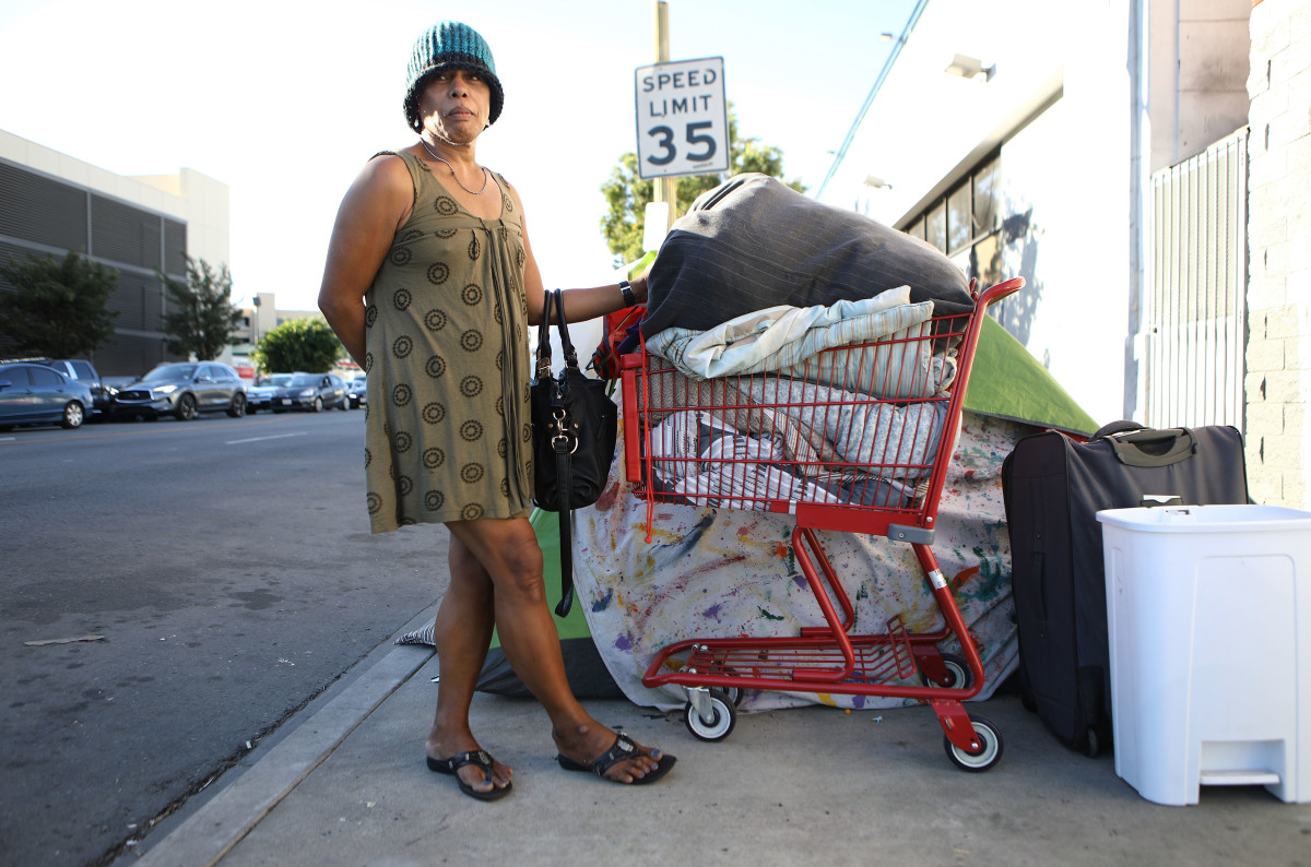 An unnamed homeless woman poses with her belongings on November 2nd, 2018, in Los Angeles, California.