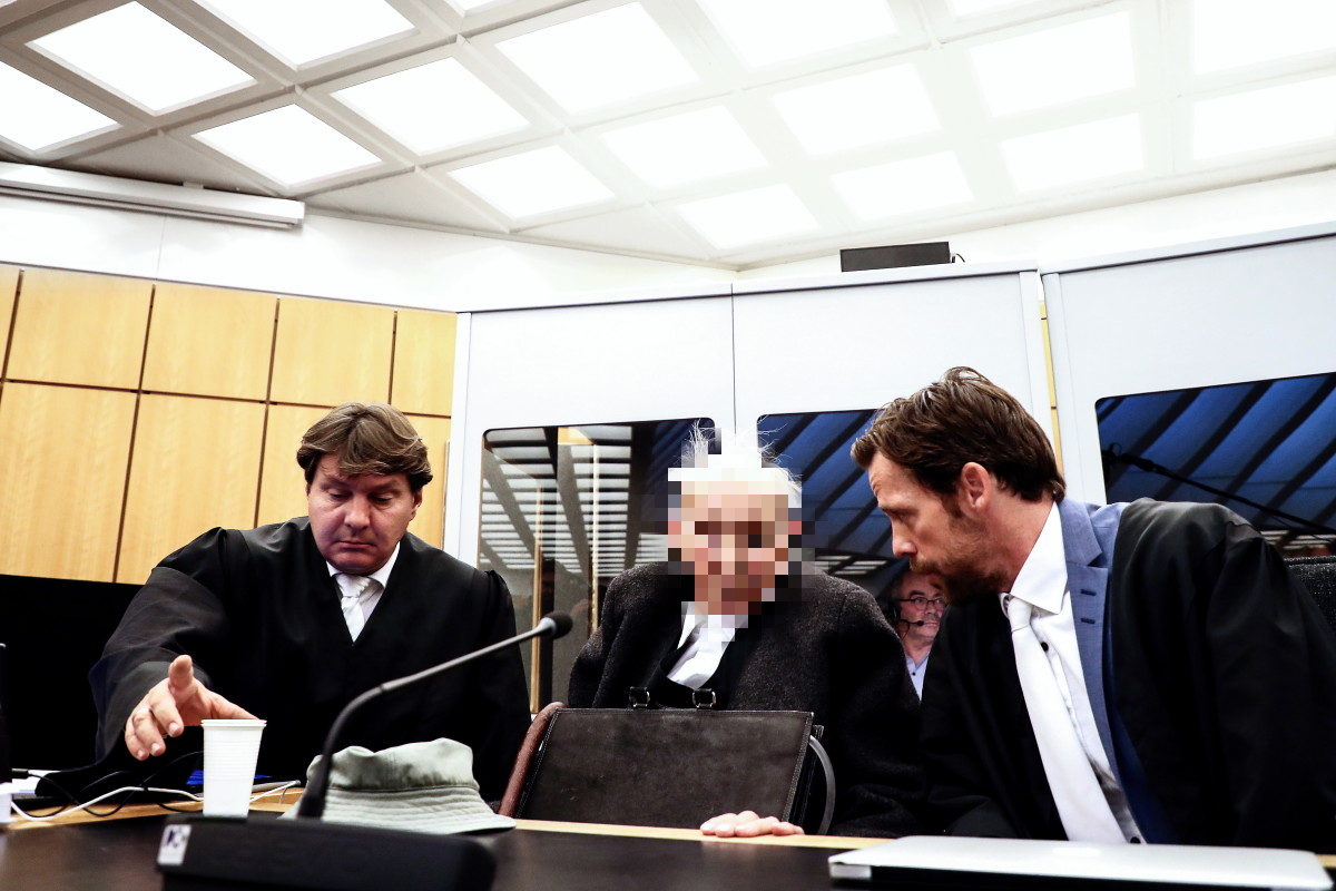 Defendant Dr. Johann R., whose face is pixelated by court order, sits with his lawyers at a session of his trial at the Regional Court in Muenster, Germany, on November 6th, 2018. The 94-year-old former SS guard faces trial, charged with complicity in the mass murders at the Nazi concentration camp Stutthof during World War II. Johann R. was a watchman at the Nazi camp near what was then the free city of Danzig, now Gdansk, in Poland. He also stands accused of complicity in the murders of several hundred camp prisoners between 1942 and 1945. As the former SS guard was not yet 21 at the time of the crimes, he will be tried before a juvenile court.