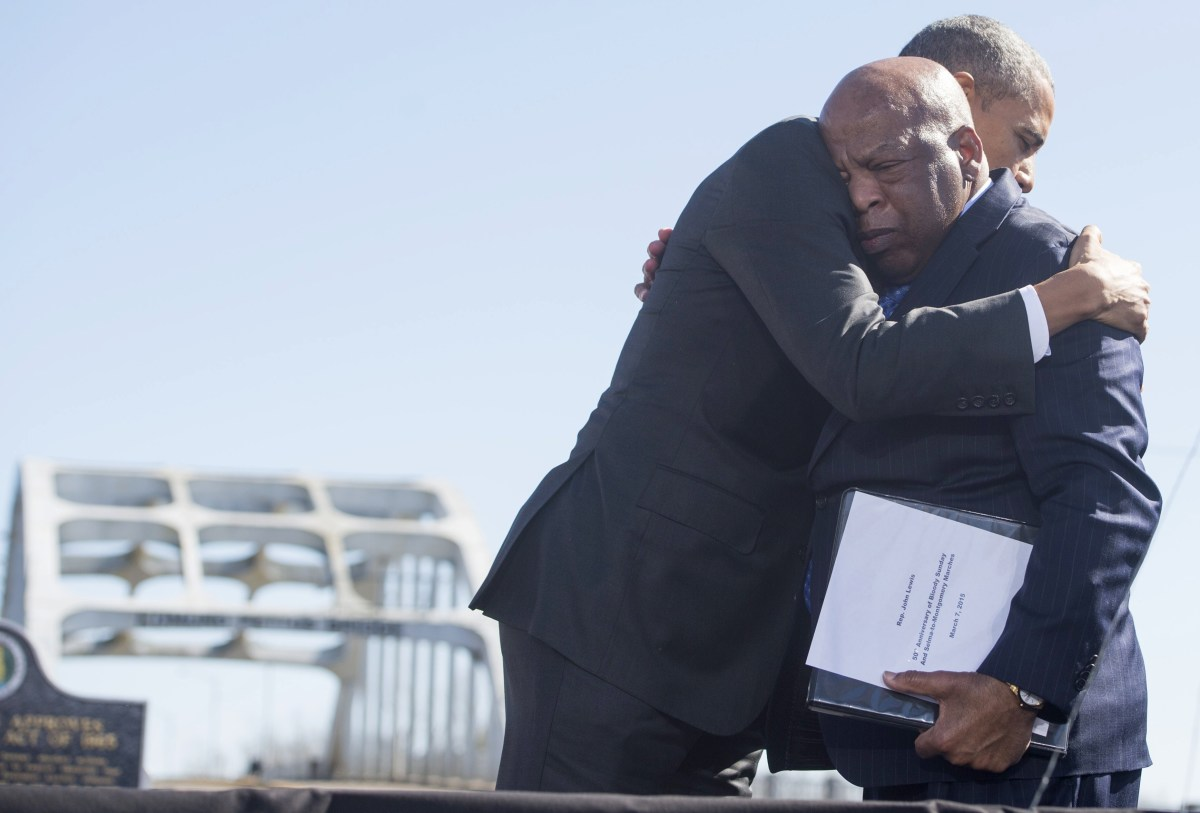Then-President Barack Obama hugs U.S. Representative John Lewis of Georgia, one of the original marchers at Selma, during an event marking the 50th anniversary of the marches from Selma to Montgomery at the Edmund Pettus Bridge in Selma, Alabama, on March 7th, 2015.