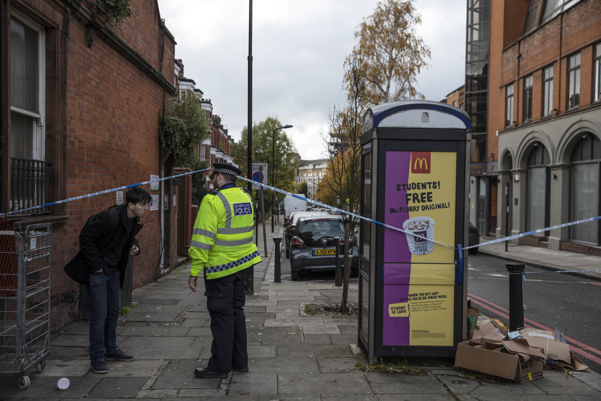 "On November 7th, 2018, a police officer lets a member of the public out of a crime scene near ""Billy Fury Way,"" where a teenager was stabbed the previous evening in London, England. The incident comes amid a wave of knife-related incidents that has seen the deaths of five people in the last six days. The boy is reported to be in a critical condition. Scotland Yard Commander Stuart Cundy said additional police officers were being deployed in every borough after a ""terrible"" few days."