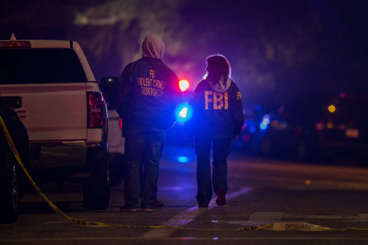 Federal Bureau of Investigation agents monitor the scene near the Borderline Bar & Grill, where a mass shooting occurred, on November 8th, 2018, in Thousand Oaks, California. At least 12 people have died, including a Ventura County Sheriff's Department sergeant. The gunman is also thought to have shot himself.