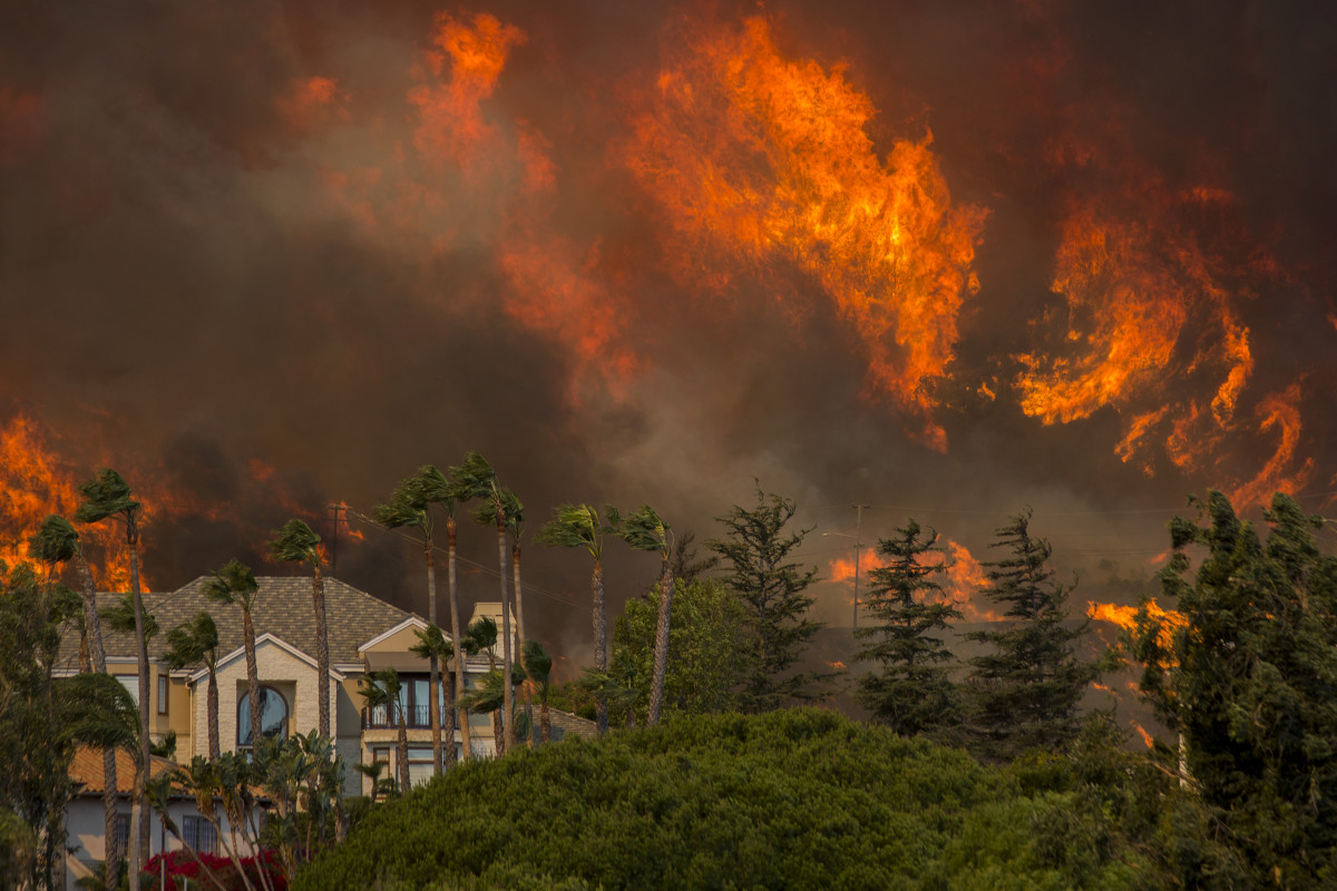 The Woolsey fire approaches homes on November 9th, 2018, in Malibu, California.