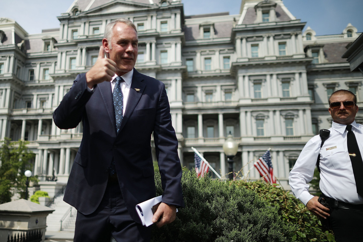 Secretary of the Interior Ryan Zinke talks to journalists outside the White House before a cabinet meeting with President Donald Trump on August 16th, 2018.