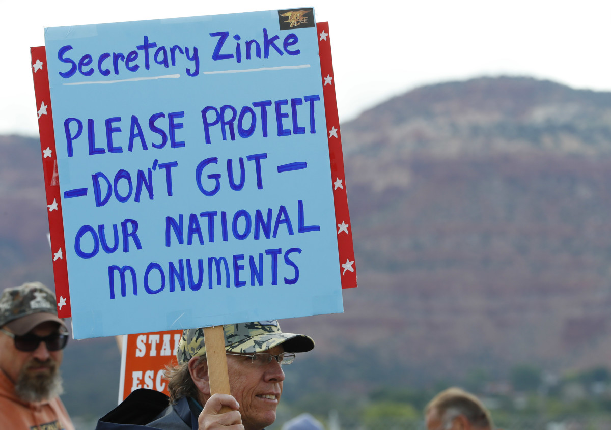 A man holds a sign on May 10th, 2017, protesting the shrinking of Bears Ears and Grand Staircase-Escalante National Monuments.