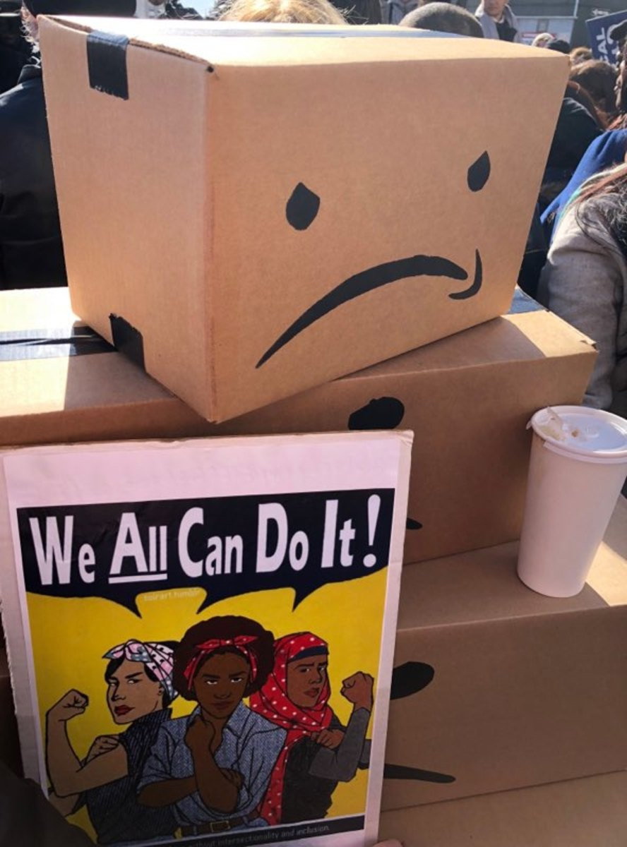 In Long Island City, HQ2 protesters' props included unhappy Amazon parody boxes and Rosie the Riveter-inspired signs.