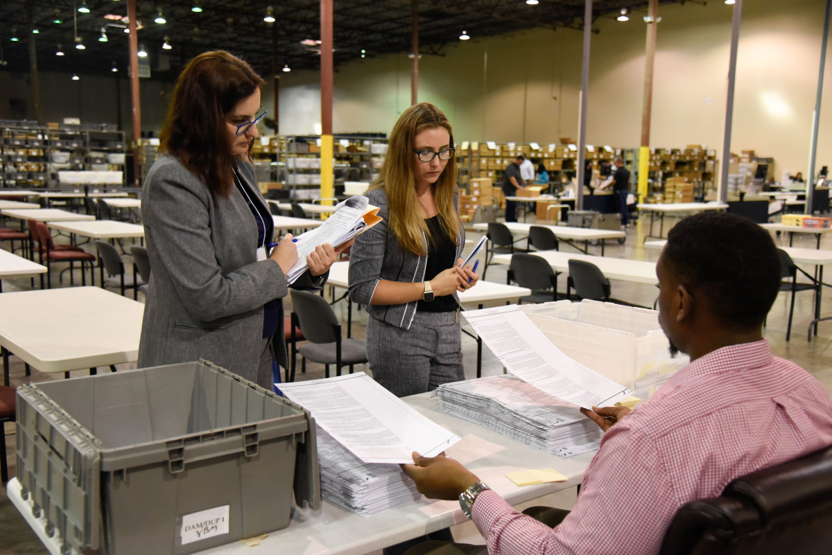 Attorneys oversee the ballot process at the Palm Beach County Supervisor of Elections Warehouse on November 15th, 2018, in West Palm Beach, Florida. Final results have yet to be declared in multiple races across the country following last week's mid-term elections, with tense recounts underway in Florida.