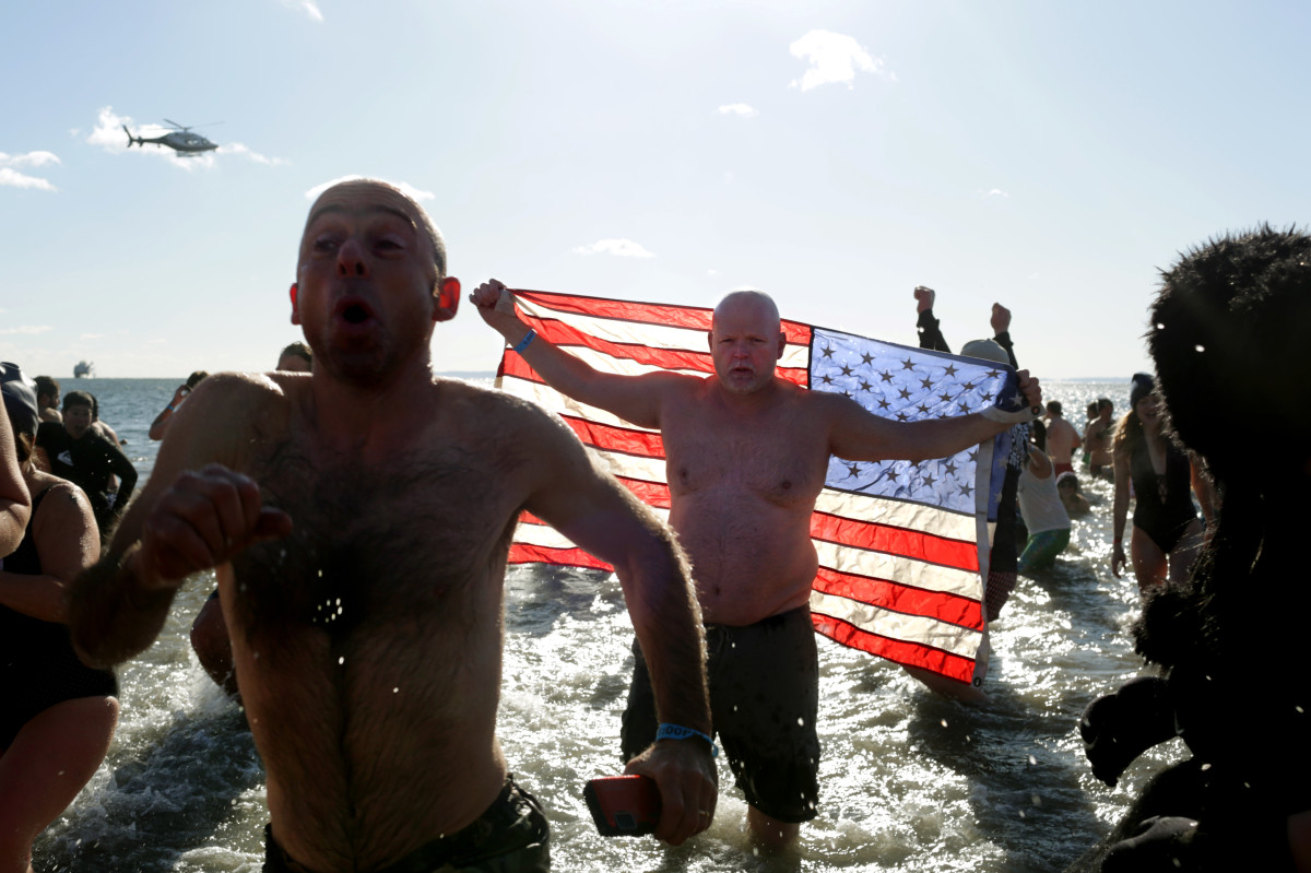 Polar Bear Club swimmers make their annual icy plunge into the Atlantic Ocean on New Year's Day at Coney Island in the Brooklyn borough of New York City.