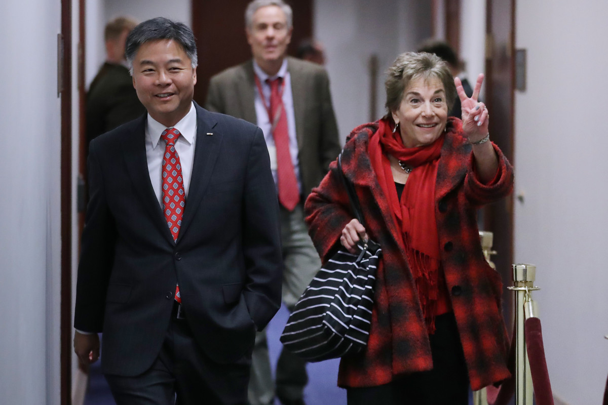 Representative Jan Schakowsky (D-Illinois) flashes a victory sign as she and Representative Ted Lieu (D-California) arrive for a Democratic caucus meeting in the U.S. Capitol Visitors Center on November 14th, 2018, in Washington, D.C. Democrats appear on track to gain between 35 and 40 seats in the House of Representatives once all the counting is complete, putting them in control of the chamber in 2019.